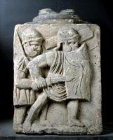 Kämpfende Legionäre, Mainz, Kästrich (aus der römischen Stadtmauer), 2. Hälfte 1. Jh. n. Chr. Jurakalkstein aus Lothringen – Landesmuseum Mainz. © GDKE, URSULA RUDISCHER