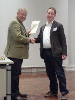 Prof. Dr. Stig Förster (1. Vors.) und Christian Kretschmer, M.A. (Preisträger)